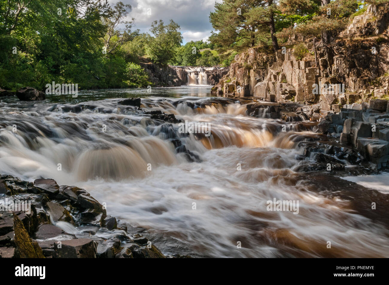 The river Tees and Low Force Waterfall in upper Teesdale on a lovely day during summer. - Stock Image