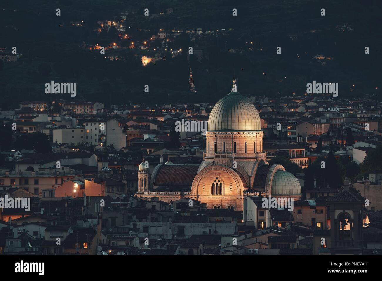 Great Synagogue of Florence or Tempio Maggiore among buildings at night. Italy. Stock Photo