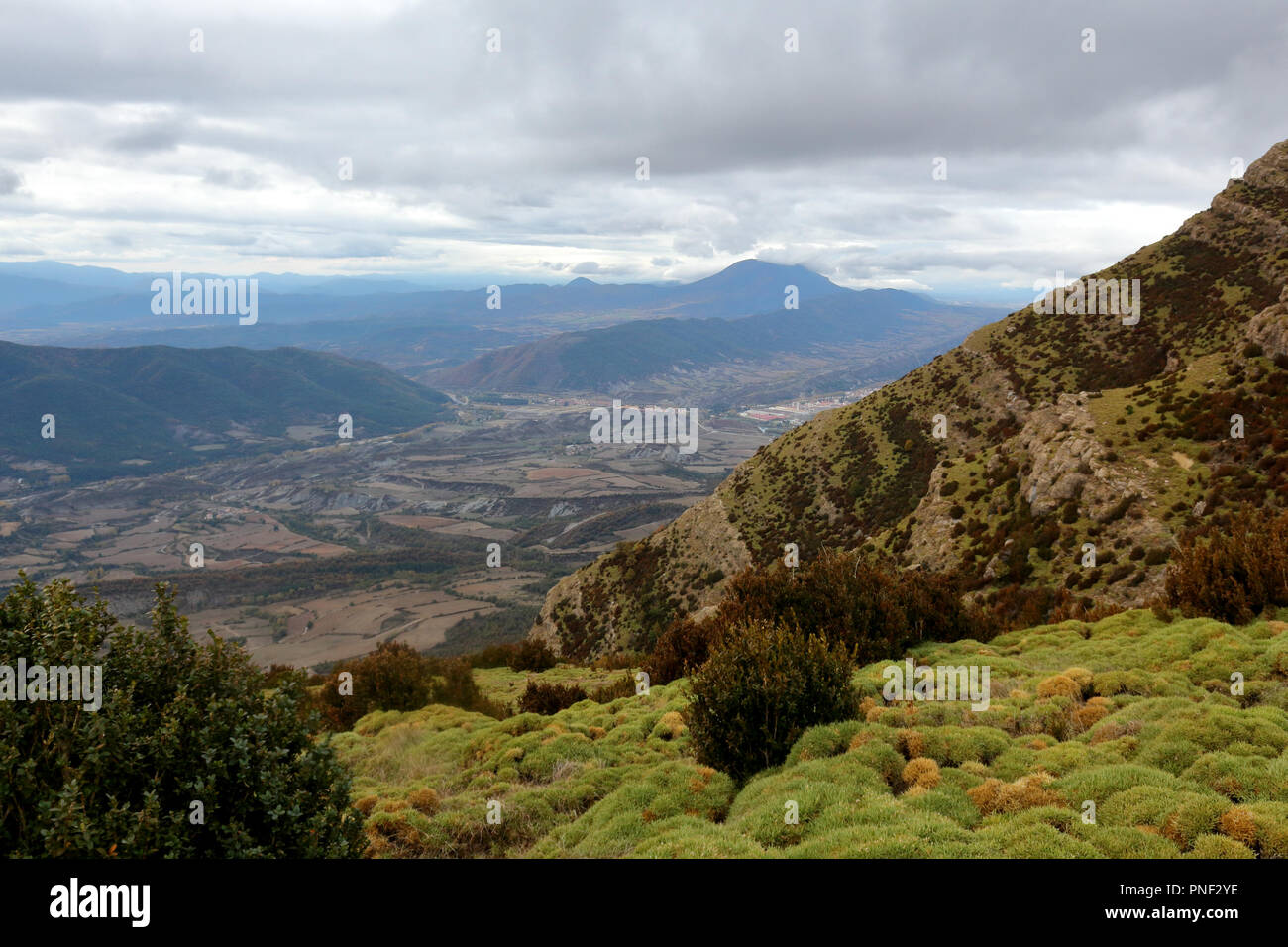 Blue cloudy sky and typical mountains and hills covered with forest met in autumn while hiking from Yebra de Basa town to Santa Orosia churc, Spain Stock Photo