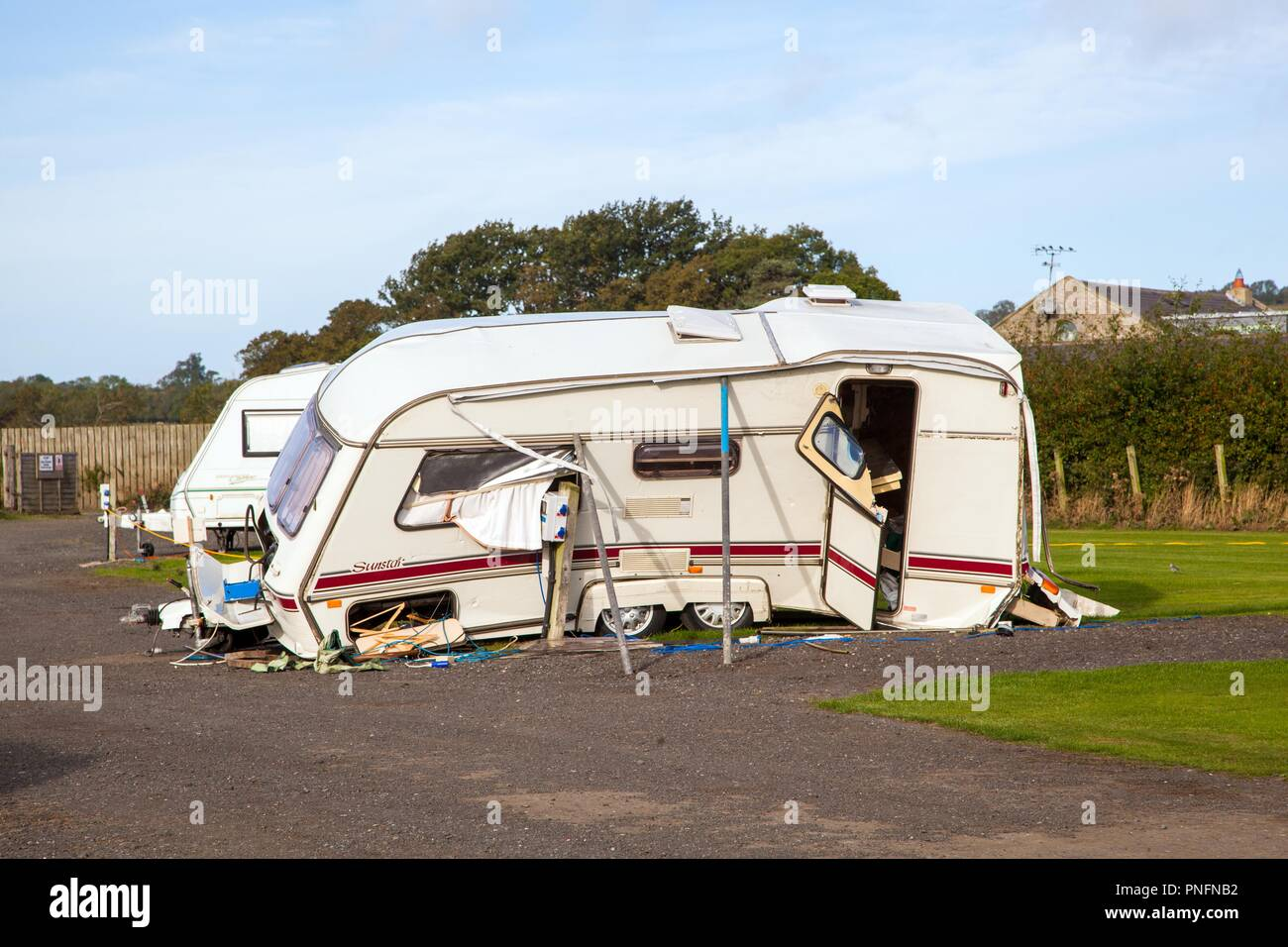 Alnwick, Northumberland. 19th September2018. UK Weather: Touring caravan blown over and wrecked in high winds during storm Ali 19th September 2018 at Alnwick Northumberland England UK Credit: Nick Hatton/Alamy Live News - Stock Image