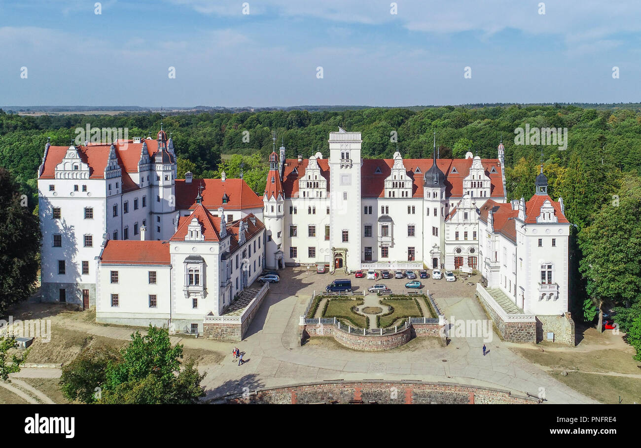 21 September 2018, Brandenburg, Boitzenburg: The castle Boitzenburg (aerial view with a drone). Almost 15 years after renovation work on the Boitzenburg castle complex, four defendants have to answer to the Potsdam Regional Court for subsidy fraud. The neo-renaissance castle is picturesquely situated between forests and fields. Boitzenburg Castle was first mentioned in documents as a castle complex in 1276. But it's probably older. The manor house in the Boitzenburger Land is one of the largest castles in the Uckermark. For centuries it was the ancestral seat of the von Arnim family and today - Stock Image