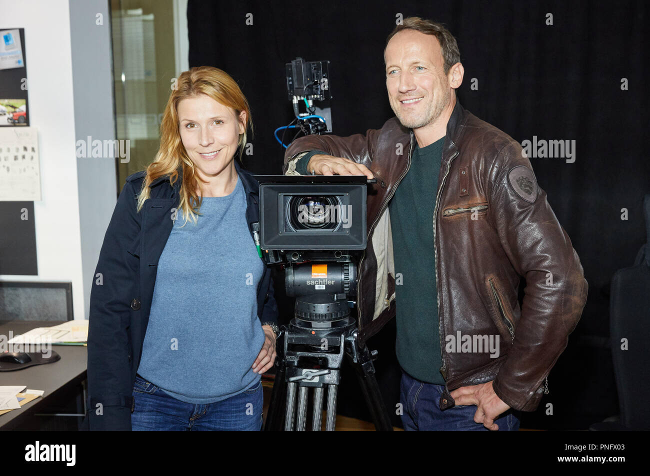 21 September 2018, Hamburg: Actors Wotan Wilke Moehring and Franziska Weisz standing on the set of the NDR crime series 'Tatort: Kollateralschaden' ('Crime scene: Collateral damages') during a photo shoot. Dar Erste will tentatively release the episode next year. Photo: Georg Wendt/dpa - Stock Image