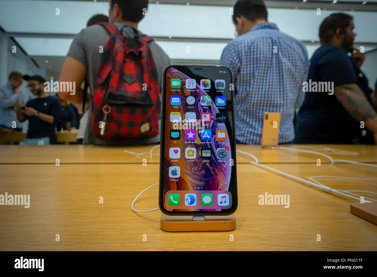 New York, USA. 21st September 2018. Customers in the Apple store in the WTC Transportation Hub in New York try out the new iPhone XS on Friday, September 21, 2018, the first day they went on sale.  The new phones, anxiously awaited by drooling iPhone aficionados, sell for a whopping $999 for the XS and $1099 for the XS Max with the Max having a 6.5 inch display.  (© Richard B. Levine) Credit: Richard Levine/Alamy Live News Credit: Richard Levine/Alamy Live News - Stock Image
