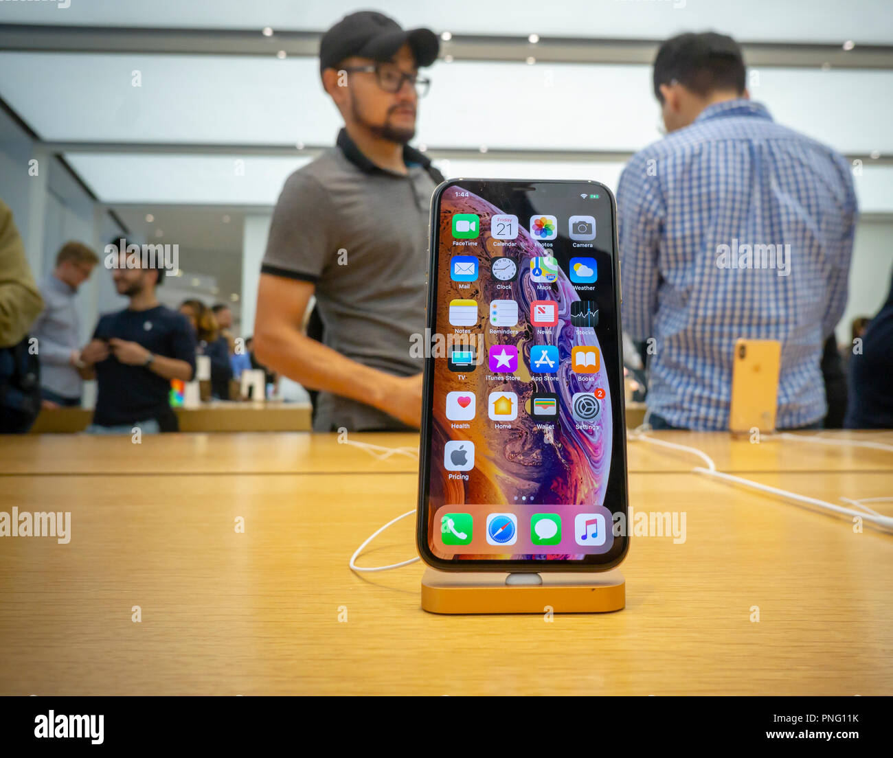 New York, USA. 21st September 2018. Customers in the Apple store in the WTC Transportation Hub in New York try out the new iPhone XS on Friday, September 21, 2018, the first day they went on sale.  The new phones, anxiously awaited by drooling iPhone aficionados, sell for a whopping $999 for the XS and $1099 for the XS Max with the Max having a 6.5 inch display.  (© Richard B. Levine) Credit: Richard Levine/Alamy Live News Credit: Richard Levine/Alamy Live News Stock Photo