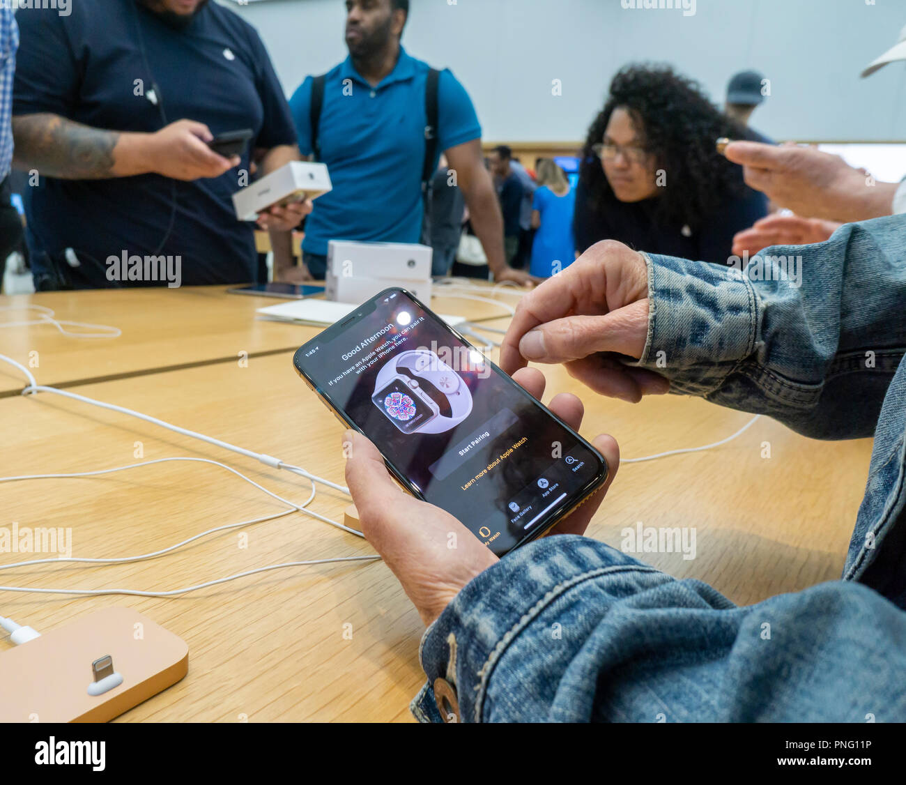 New York, USA. 21st September 2018. A customer in the Apple store in the WTC Transportation Hub in New York tries out the new iPhone XS on Friday, September 21, 2018, the first day they went on sale.  The new phones, anxiously awaited by drooling iPhone aficionados, sell for a whopping $999 for the XS and $1099 for the XS Max with the Max having a 6.5 inch display.  (© Richard B. Levine) Credit: Richard Levine/Alamy Live News Credit: Richard Levine/Alamy Live News Stock Photo