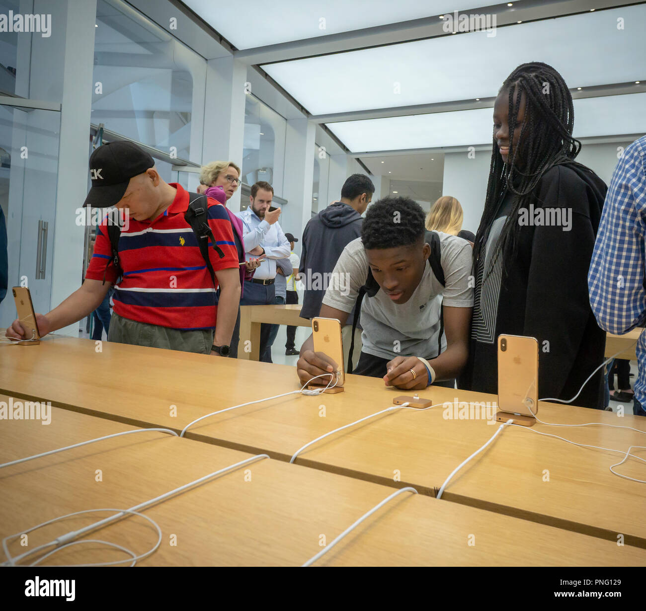 New York, USA. 21st September 2018. Customers in the Apple store in the WTC Transportation Hub in New York try out the new iPhone XS and XS Max on Friday, September 21, 2018, the first day they went on sale.  The new phones, anxiously awaited by drooling iPhone aficionados, sell for a whopping $999 for the XS and $1099 for the XS Max with the Max having a 6.5 inch display.  (© Richard B. Levine) Credit: Richard Levine/Alamy Live News Credit: Richard Levine/Alamy Live News - Stock Image