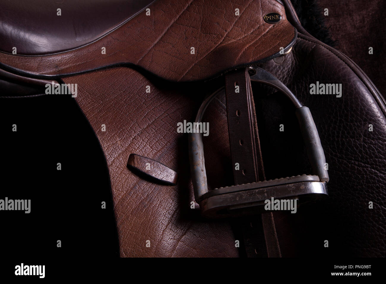 Buffalo hide leather English saddle low light - Stock Image