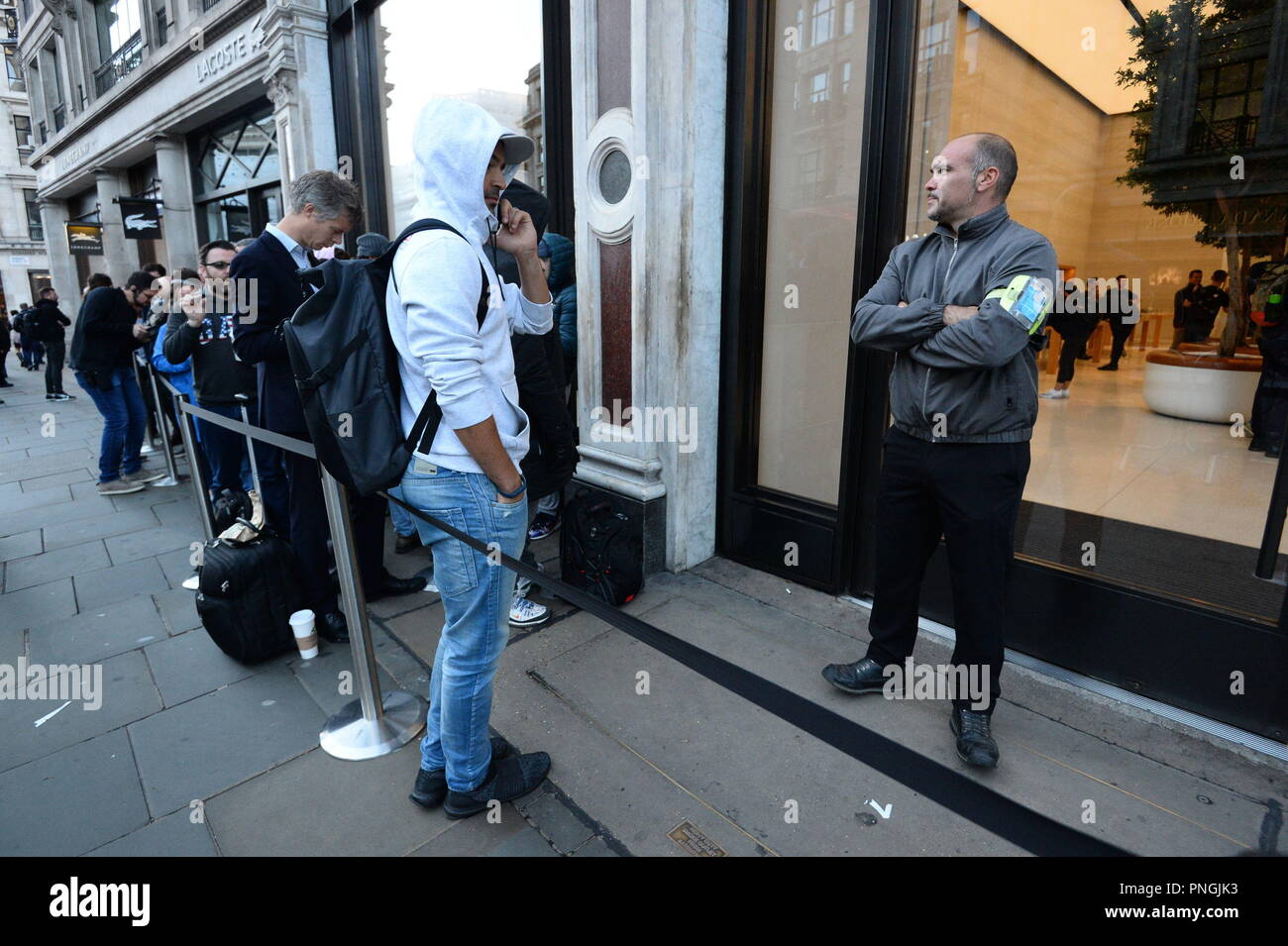 Customers queue outside the Apple Store in Regent Street, central London, as the iPhone XS and XS Max go on sale in the UK for the first time, alongside the Apple Watch Series 4. - Stock Image