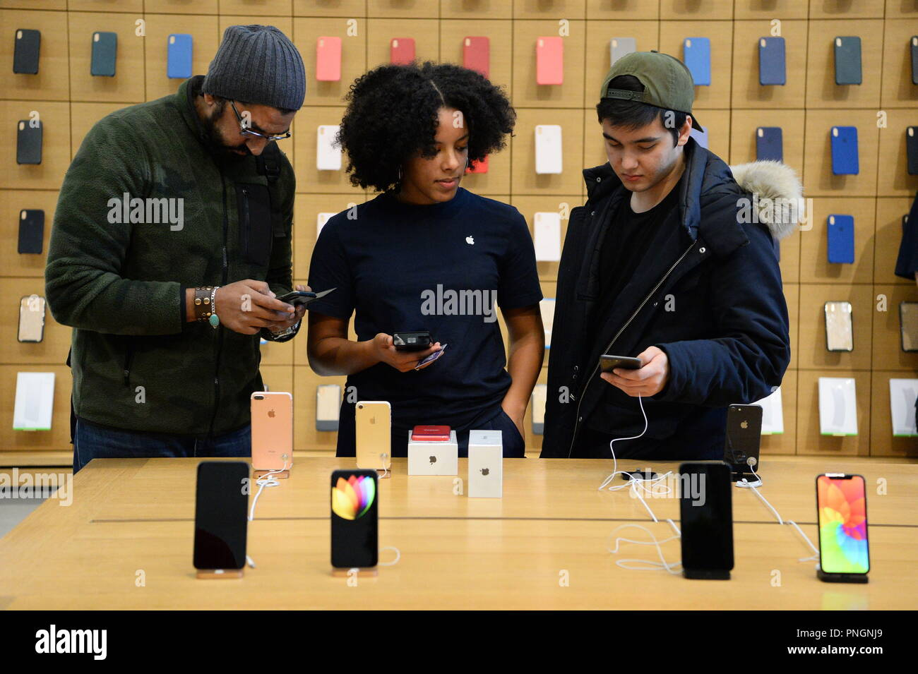 Customers in the Apple Store in Regent Street, central London try out the new products, as the iPhone XS and XS Max go on sale in the UK for the first time, alongside the Apple Watch Series 4. - Stock Image