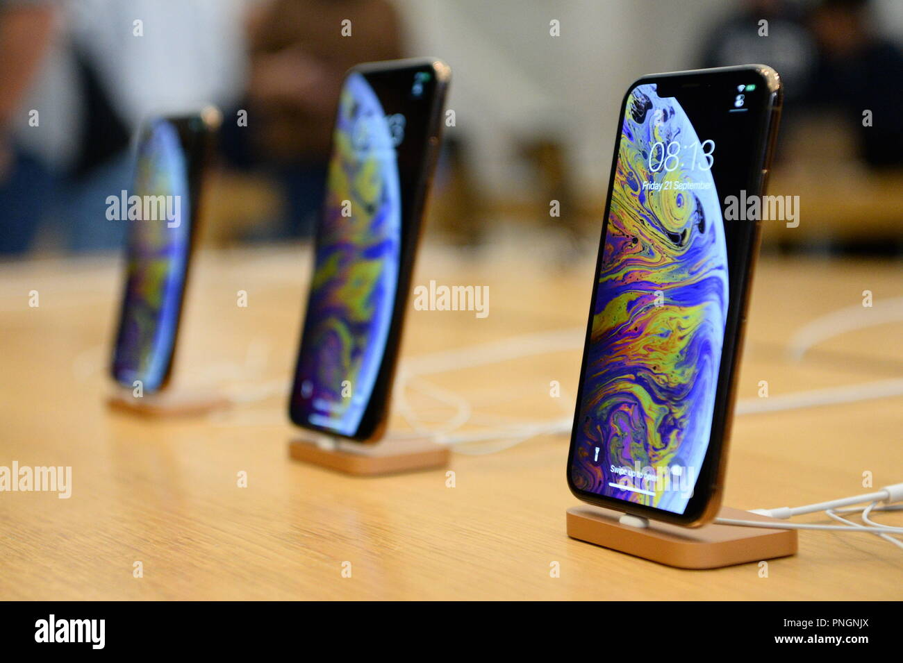 A display of the new iPhone XS and iPhone XS Max in the Apple Store in Regent Street, central London, as they go on sale in the UK for the first time, alongside the Apple Watch Series 4. - Stock Image