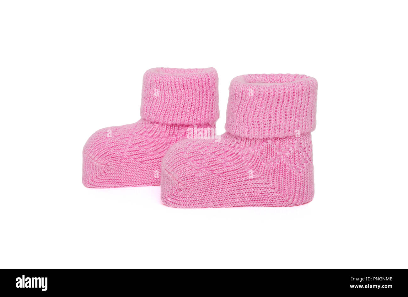 Pink knitted baby socks for girls. Close-up. - Stock Image