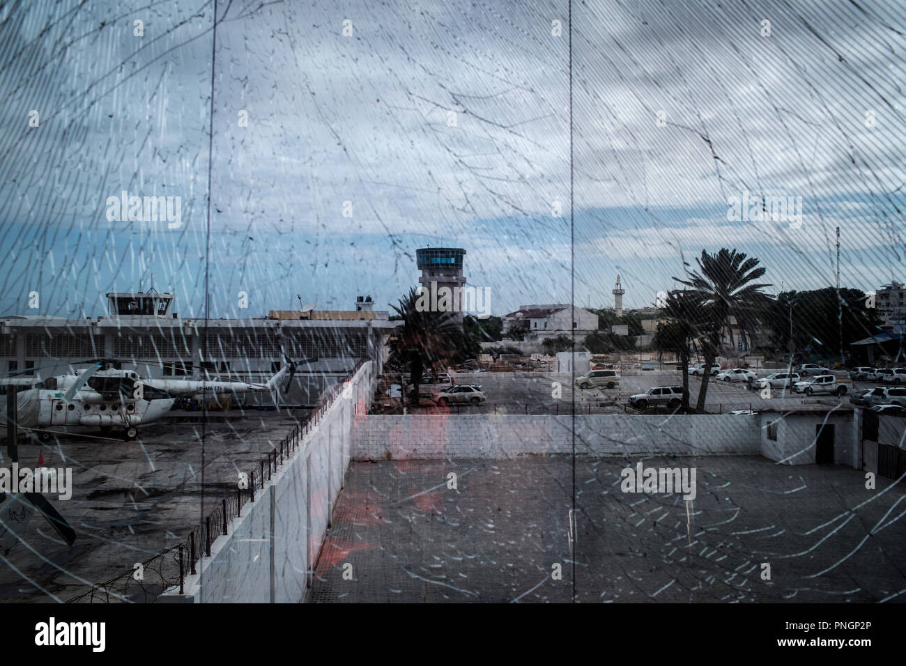 View of damaged glass due to a suicide attack shows a part of the compound of the Aden Abdulle airport in Mogadishu, Somalia, July 9, 2016. - Stock Image
