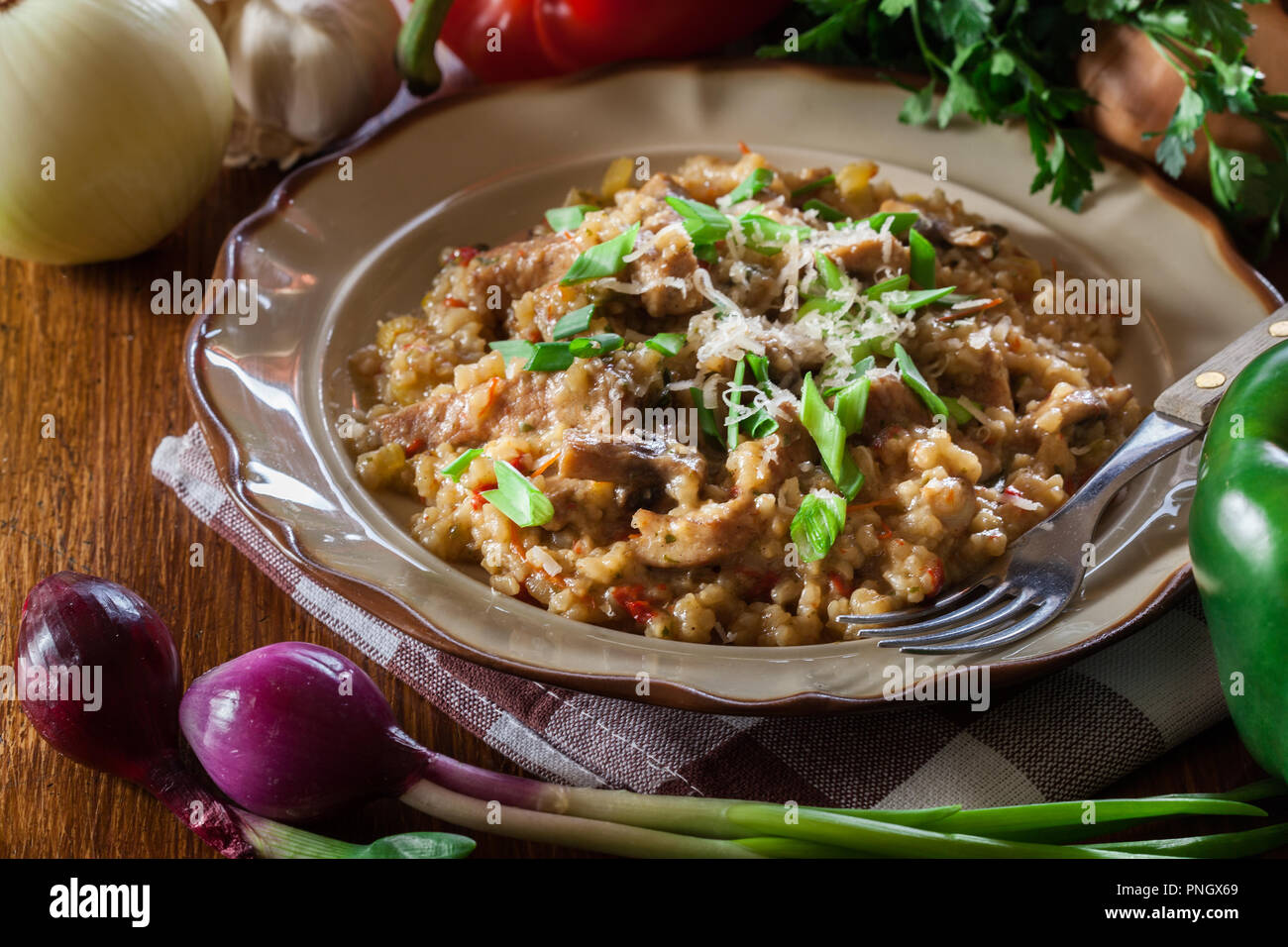 Risotto with champignon mushrooms, pork and parmesan. Italian cuisine - Stock Image