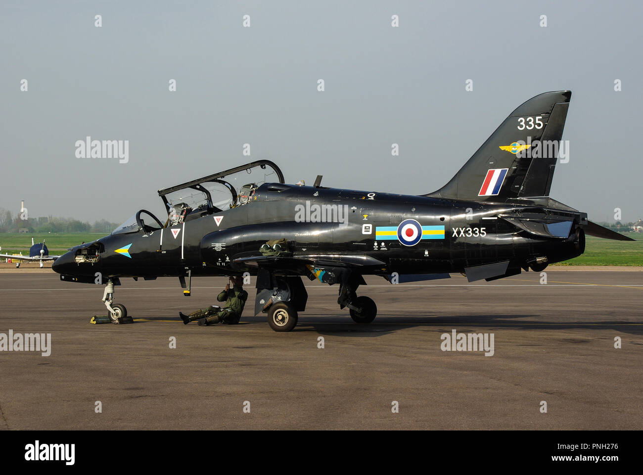 British Aerospace BAe Hawk T1 at London Southend Airport with engineer working underneath. Ready for Southend Airshow - Stock Image