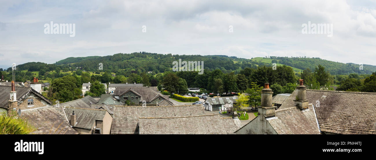 Rooftops of the village of Hawkshead in Cumbria, looking west from the mount of St. Michael and All Angels church. The village is a popular destinatio - Stock Image