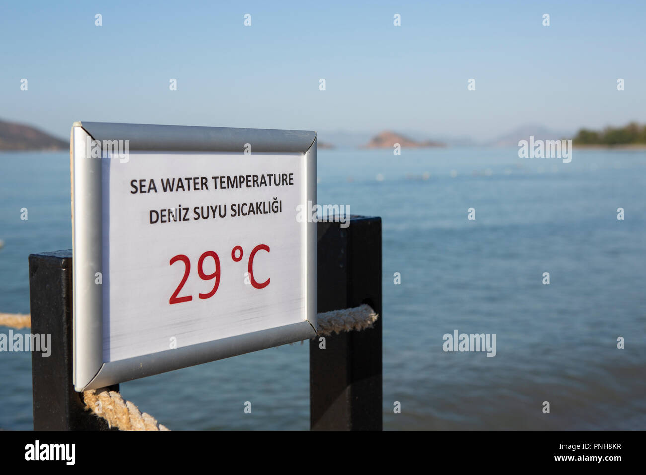 Sign in English and Turkish showing temperature of sea water - Stock Image