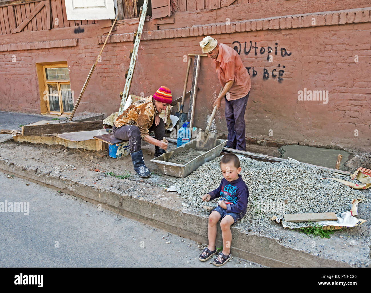 Dnipro, Ukraine - May 05, 2018: Grandfather, grandmother and grandson repair their dilapidated housing on their own Stock Photo