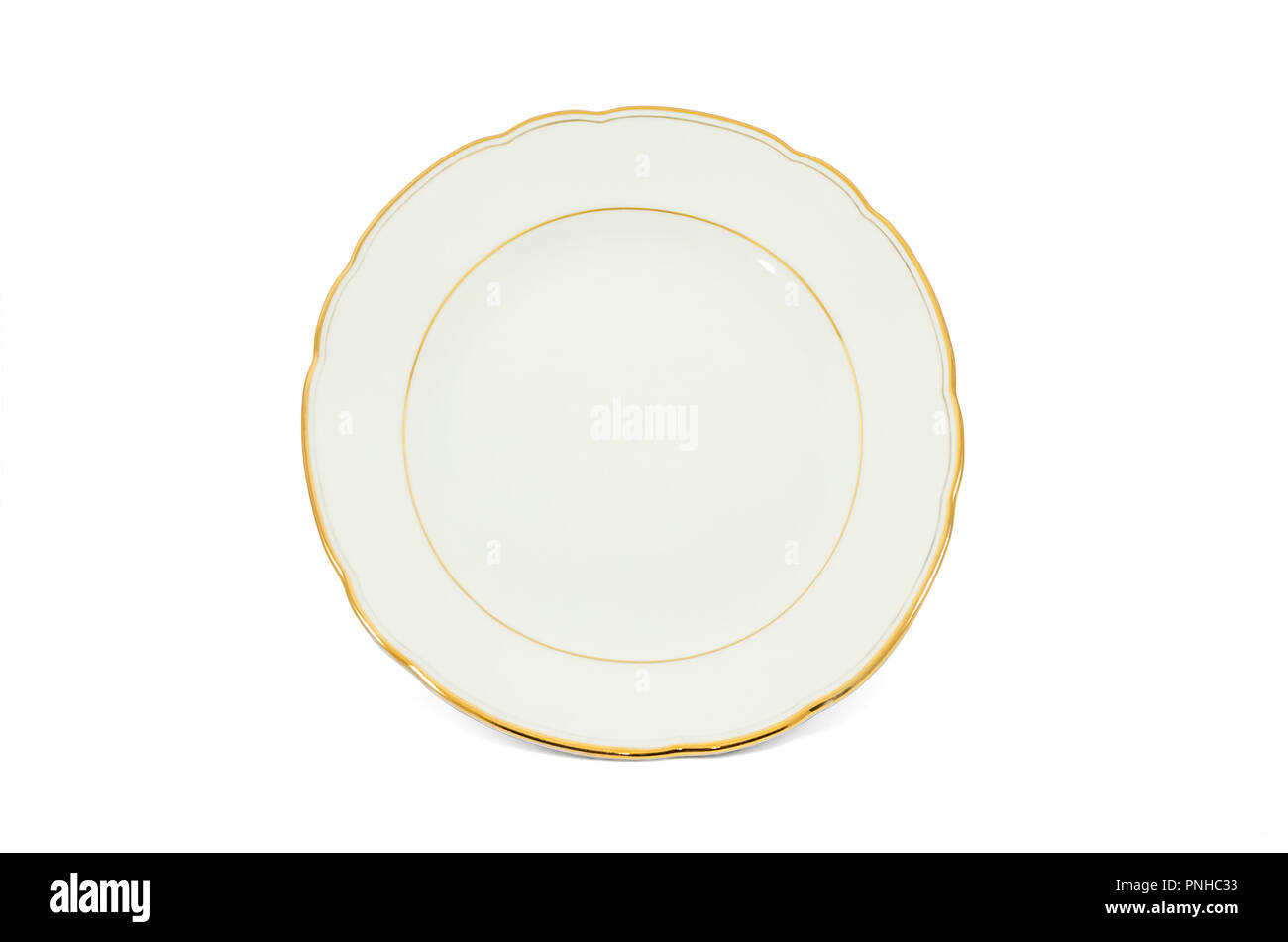 Old-fashioned porcelain dish with gilded border isolated on white background - Stock Image