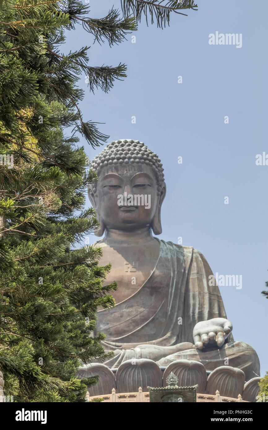 The Big Buddha statue in Ngong Ping village - Lantau Island Hong Kong - Stock Image