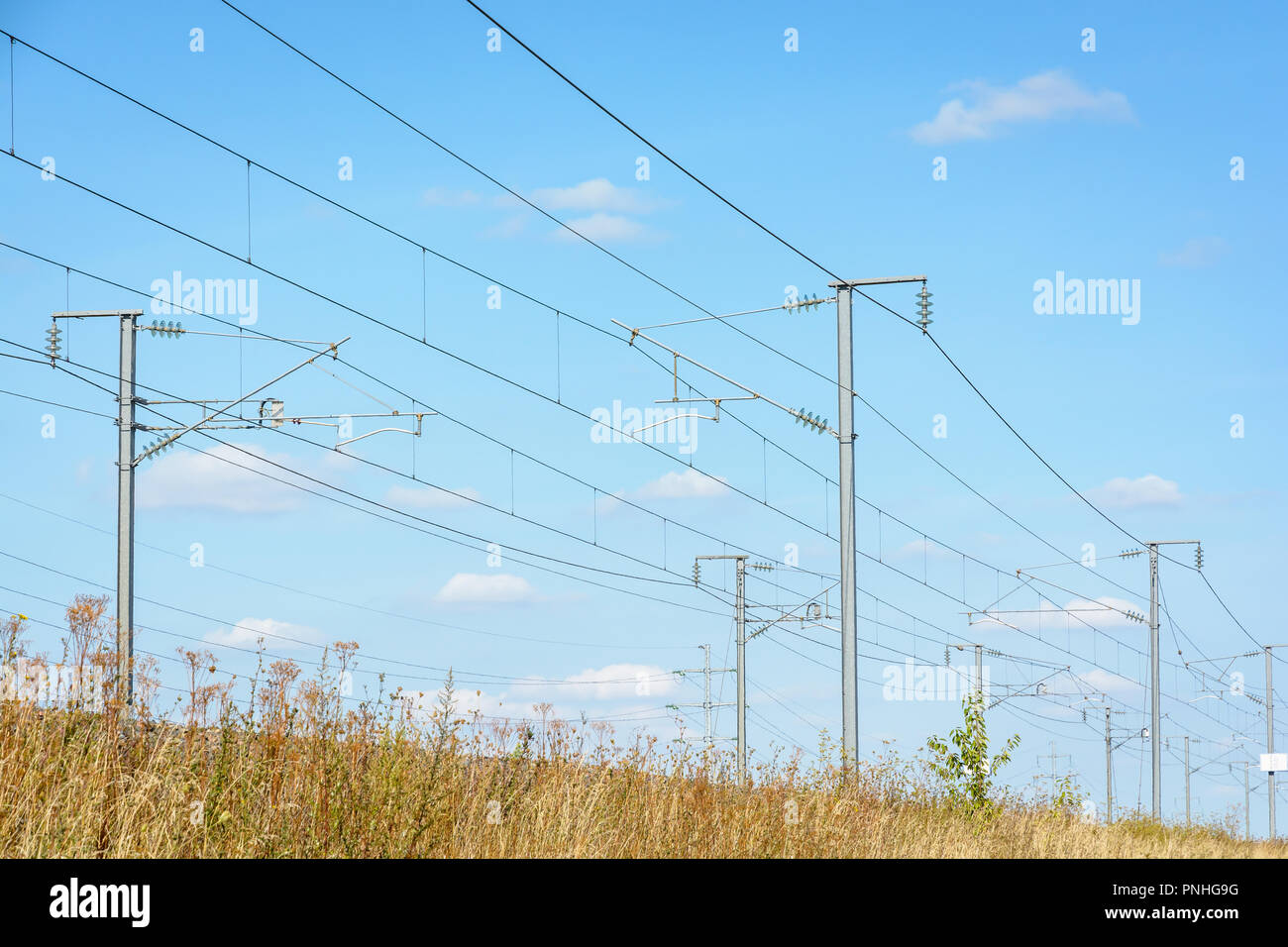 Overhead line equipment of the LGV Est, the East European high speed railway, with posts, catenaries and power lines to supply electricity to trains. Stock Photo
