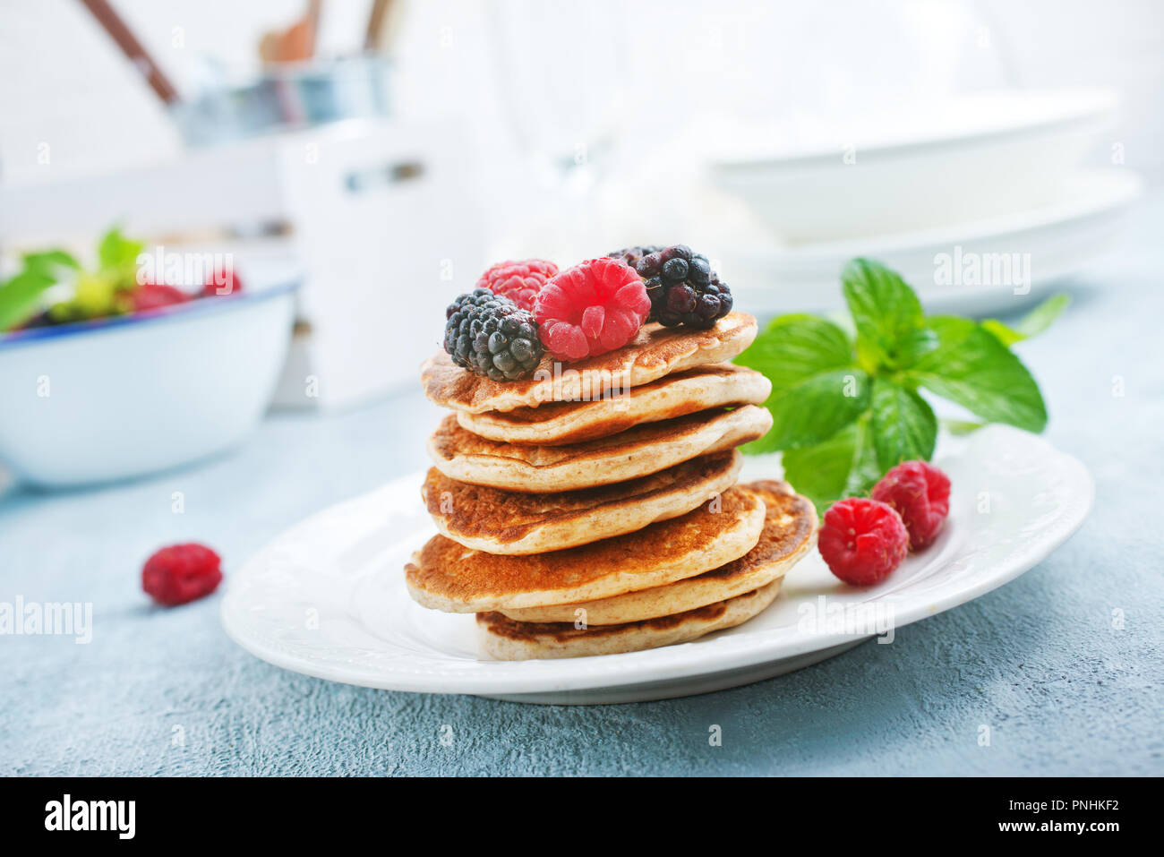pancakes with fresh berries on plate, stock photo - Stock Image