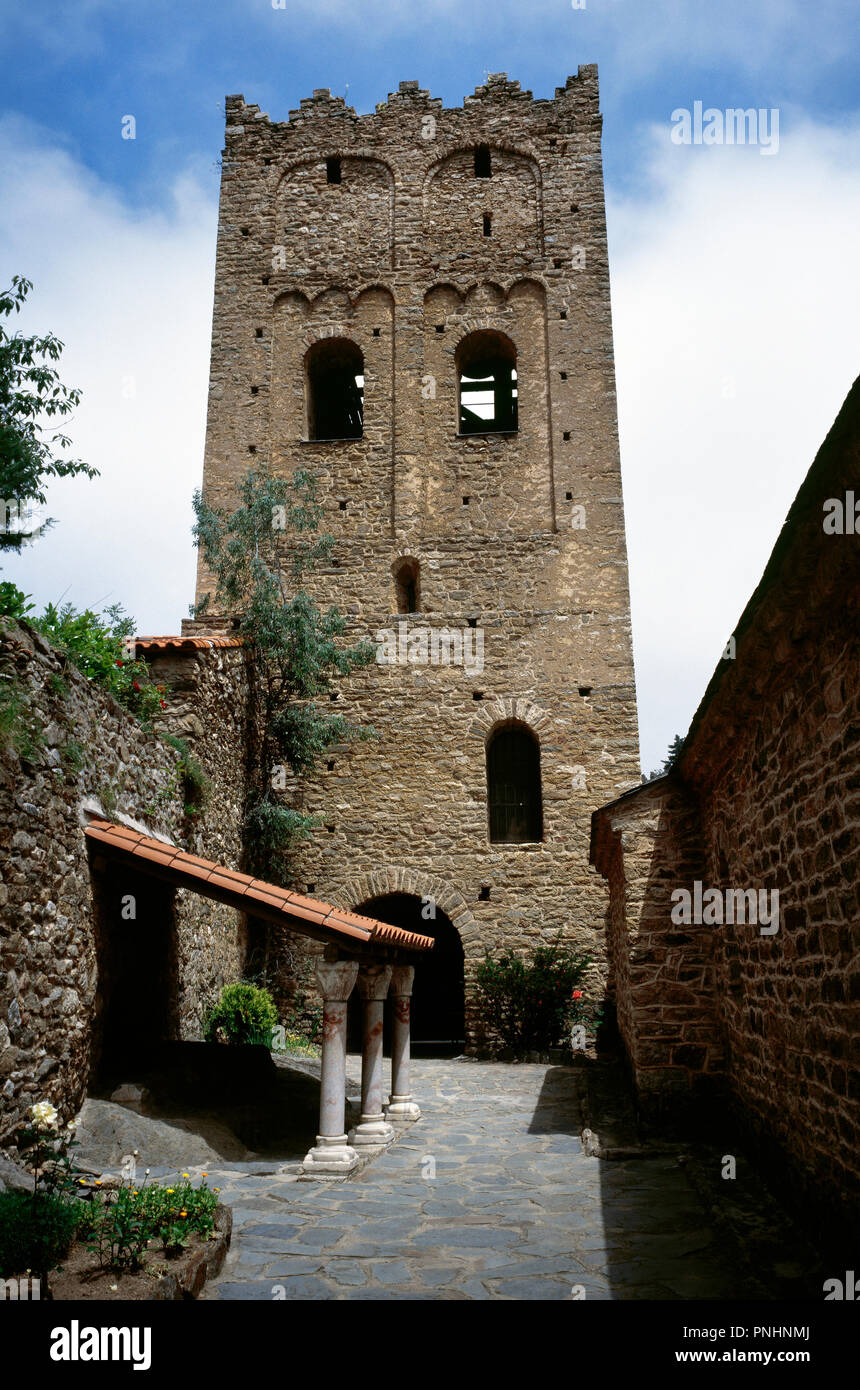France. Pyrenees-Orientales. Languedoc-Roussillon region. Abbey of Saint-Martin-du-Canigou. Monastery built in 1009, on Canigou mountain. It was built from 1005-1009 by Guifred, Count of Cerdanya in Romanesque style. View of the bell tower. Restoration of 1900-1920. - Stock Image