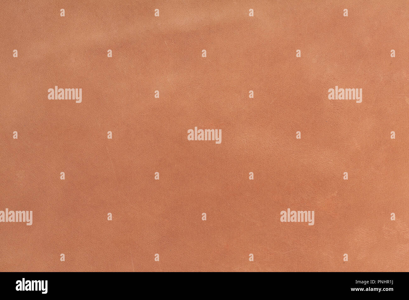 Brown grunge scratched leather to use as background. - Stock Image