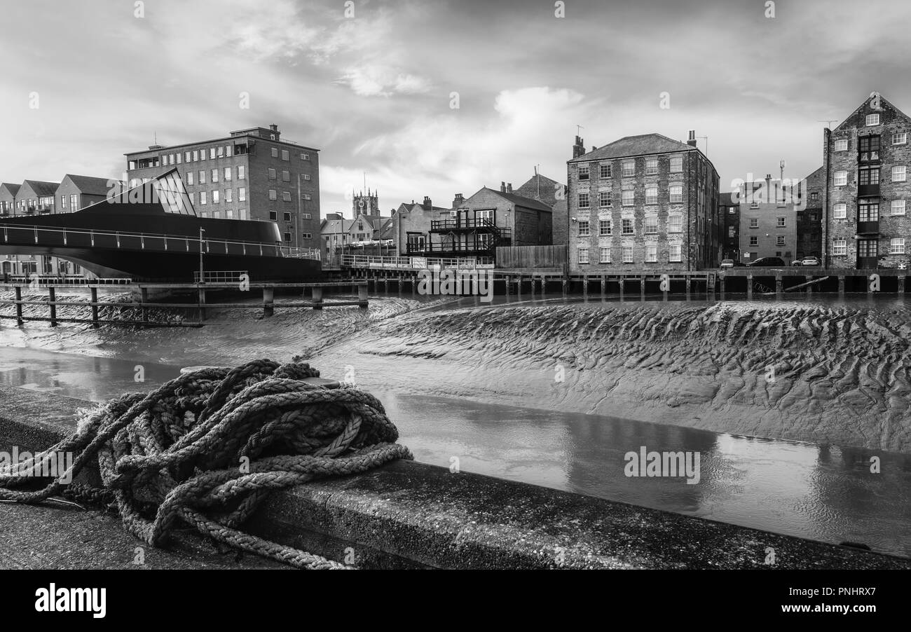 View across the river Hull in autumn with view of Scale Lane Bridge swing bridge and houses, offices and Holy Trinity Church in H - Stock Image