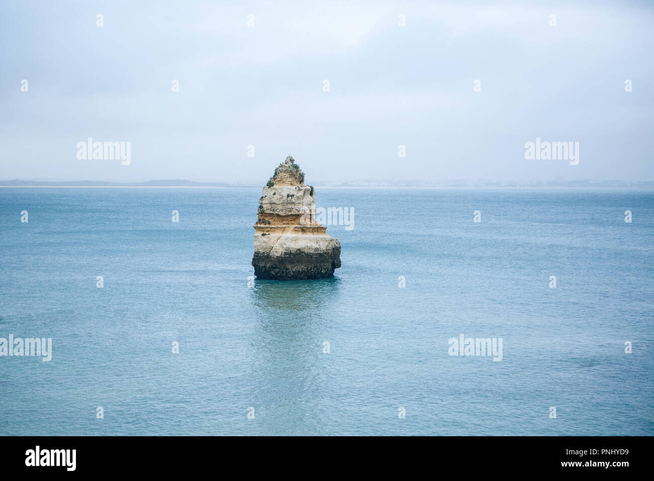 Minimalistic view of the rock in the middle of the Atlantic Ocean. Amazing natural landscape. - Stock Image