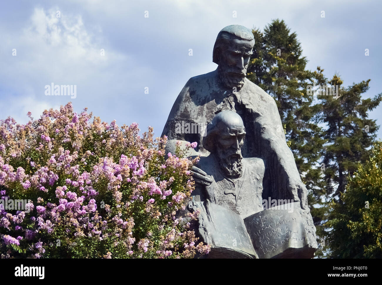 Sculpture of brothers Cyril and Methodius made of stone in Ohrid - Stock Image
