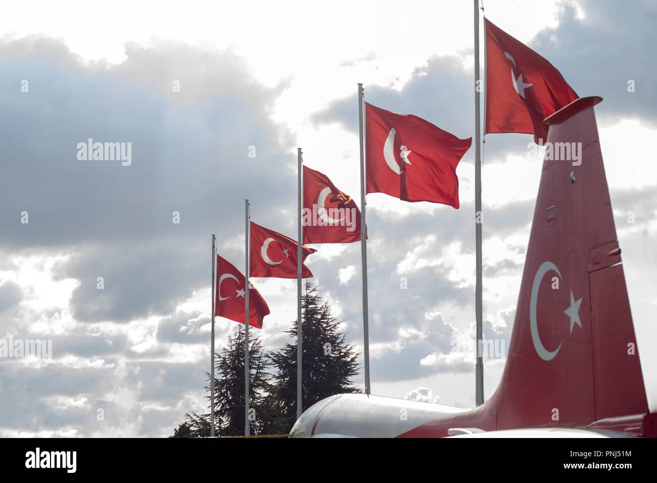 Line of Turkish flag with cropped view of a tailplane which painted as Turkish flag - Stock Image