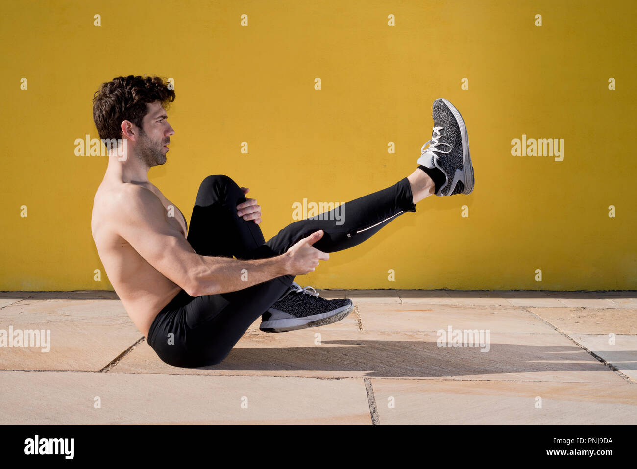 sportman warming and stretching Stock Photo