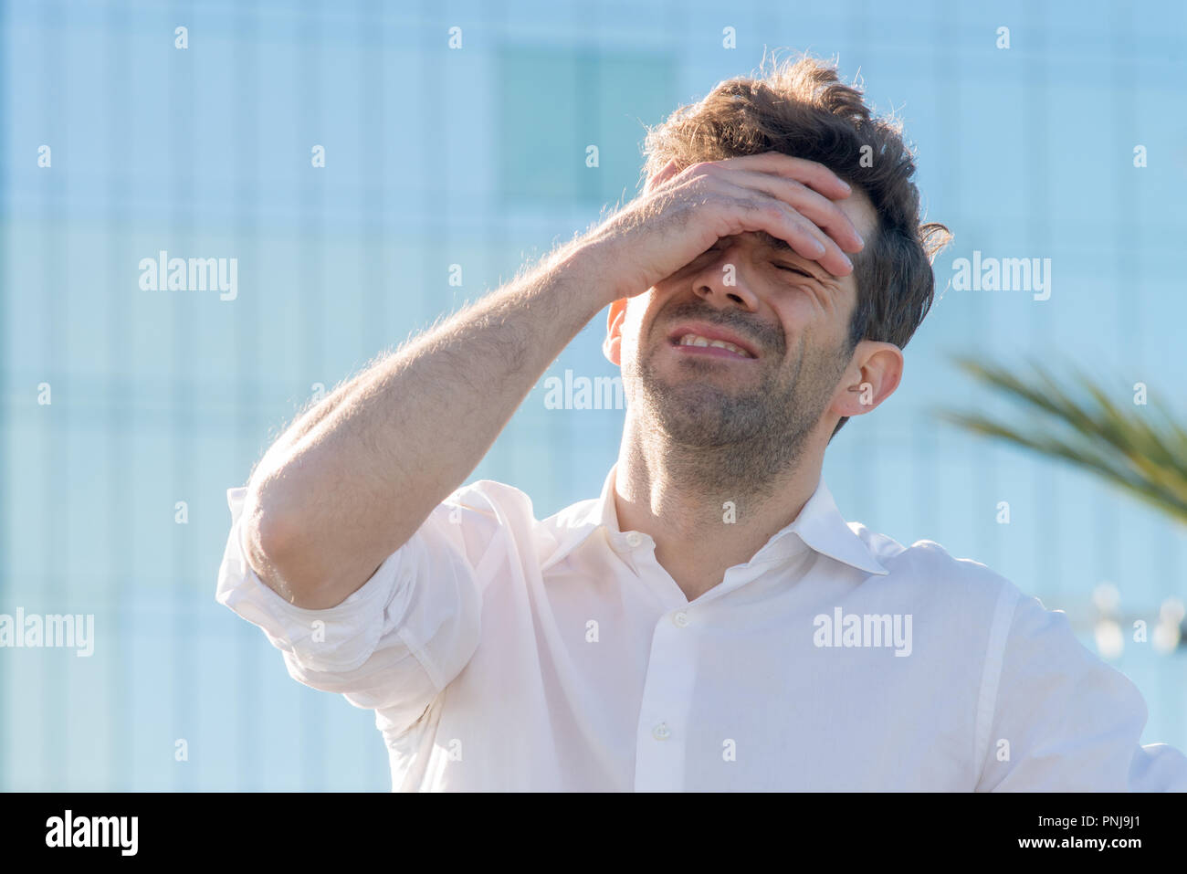 young man with stress or loser - Stock Image