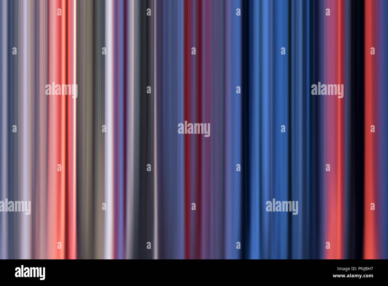 Half blurred multicolored vertical striped abstract background, curtain imitation - Stock Image