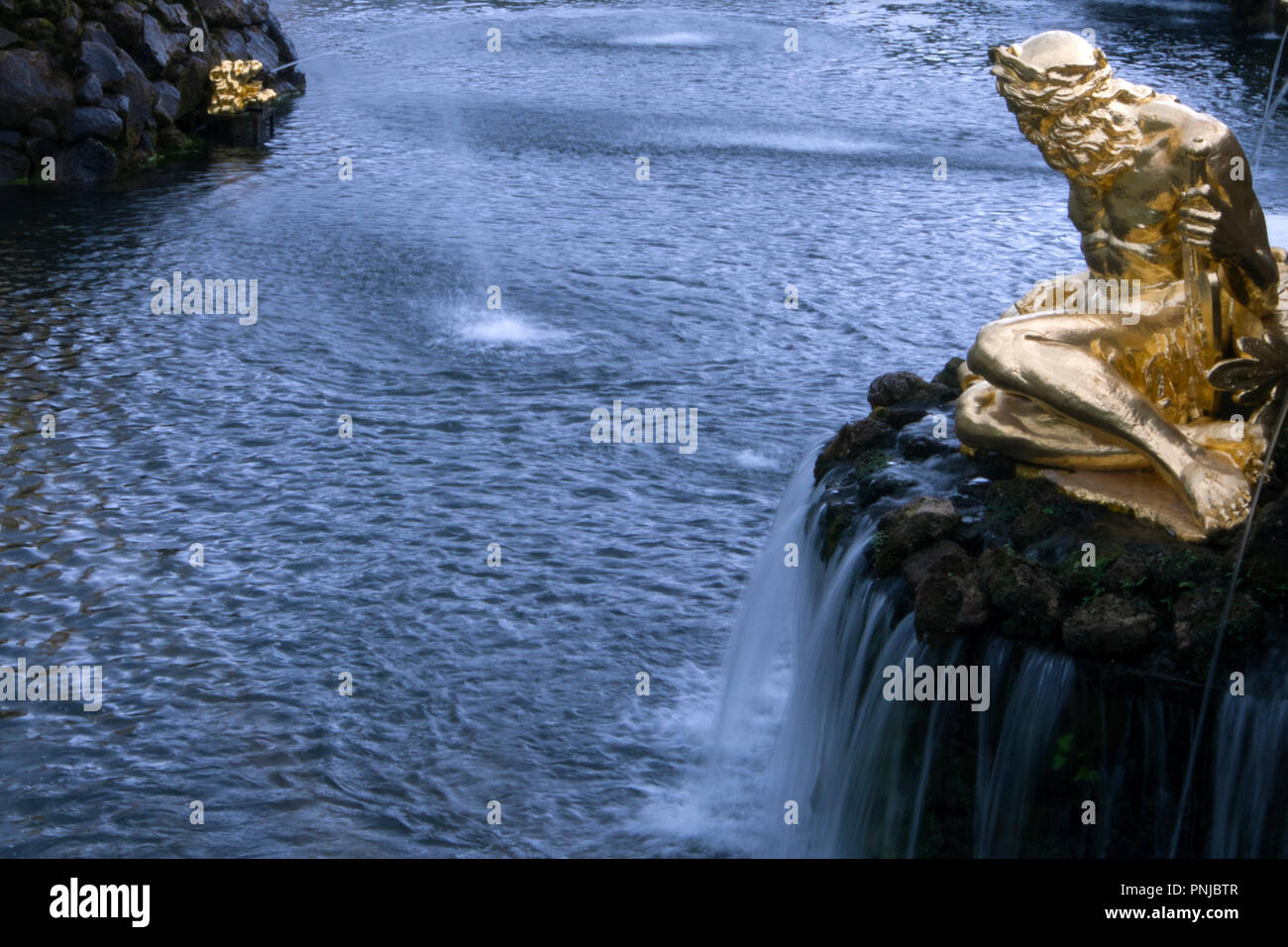 "Fountain ""Big Cascade"" in Peterhof Lower Park, Saint-Petersburg, Russia, gilded statue of Neptune, 18th century landmark Stock Photo"