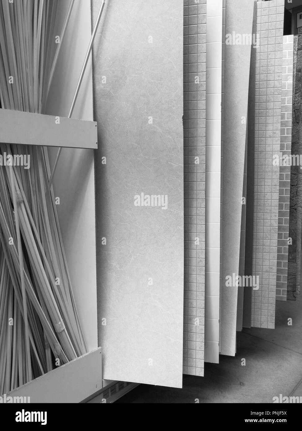 Black and white photo. Sale of PVC panels in the hypermarket. - Stock Image