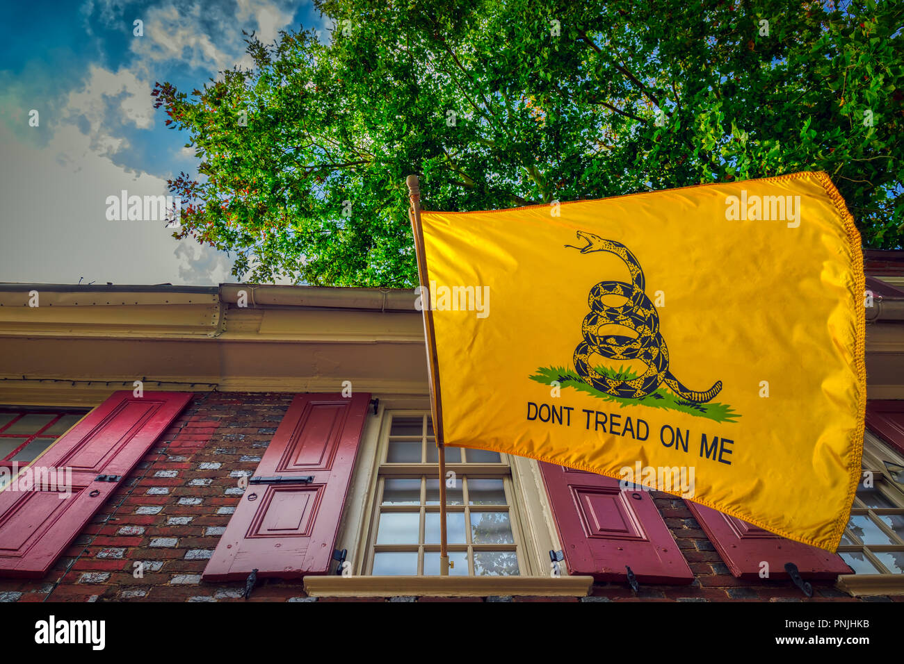 """The Gadsden flag, with """"Don't Tread On Me"""" written on it, was designed by General Christopher Gadsden during the American Revolution. - Stock Image"""