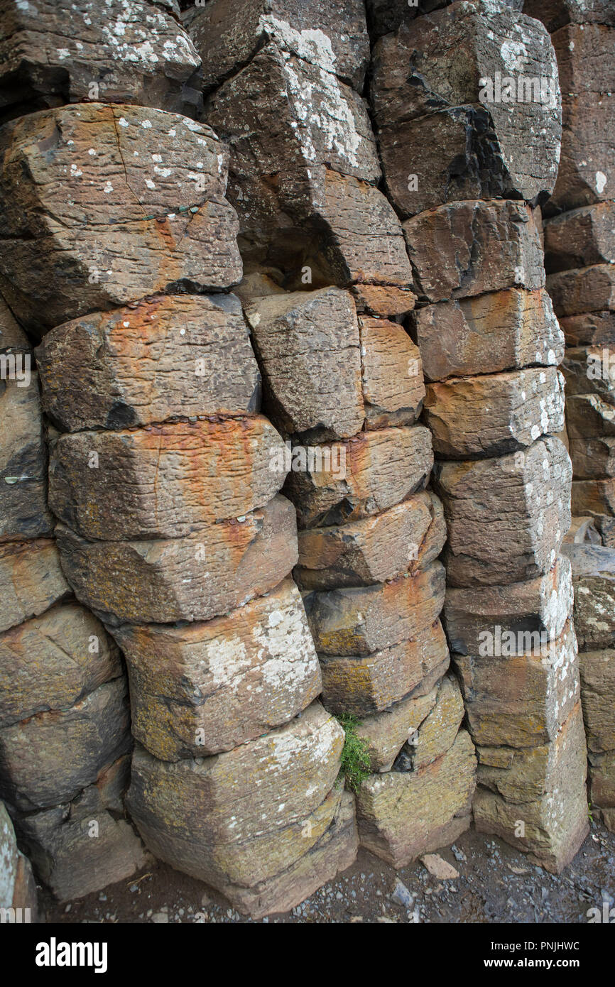 A view of the impressive natural Basalt Columns caused by an ancient volcanic fissure eruption at the Giant's Causeway in Northern Ireland. - Stock Image