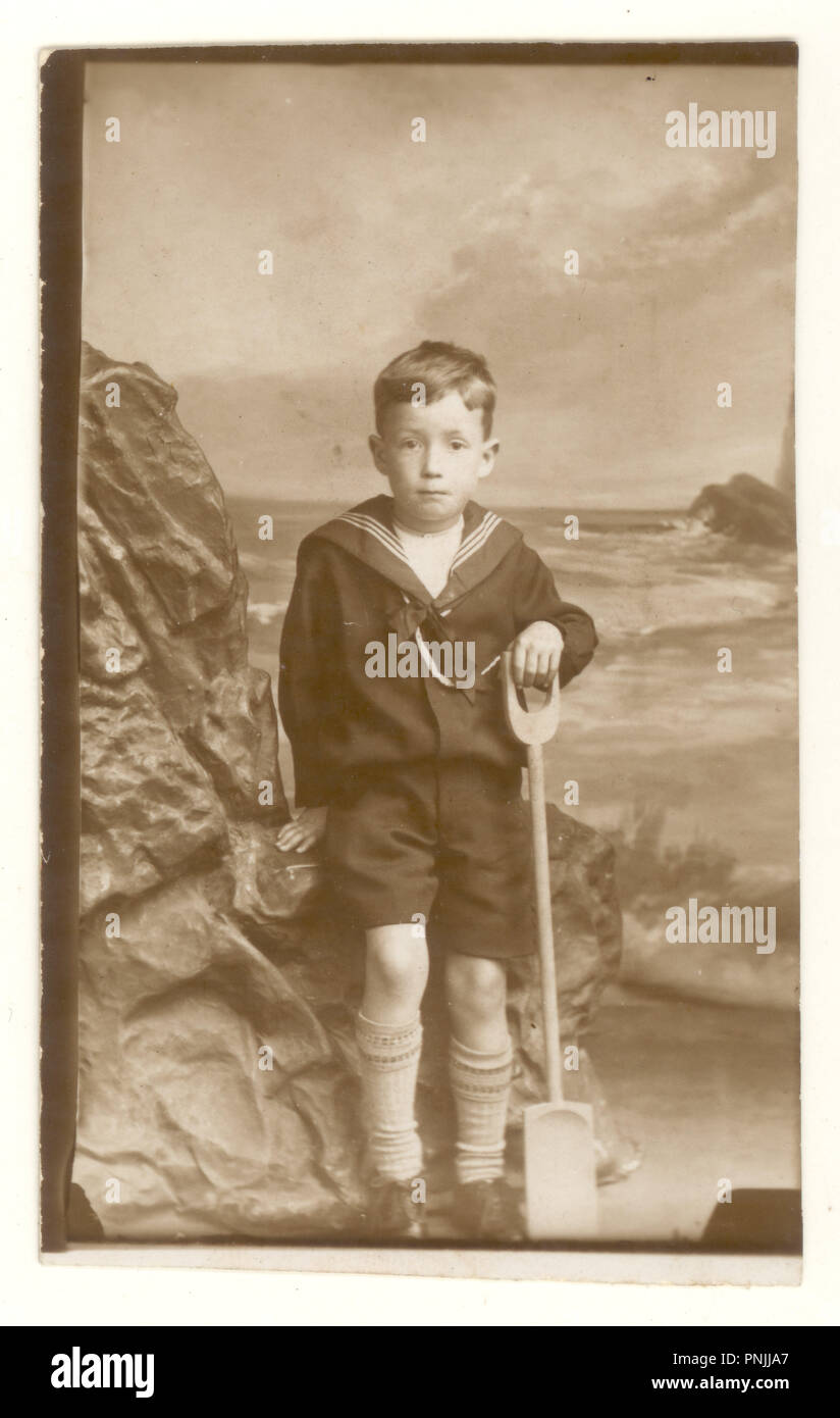 Studio seaside portrait photograph of young boy holding a spade, dated September 2 1927, Blackpool, U.K. - Stock Image