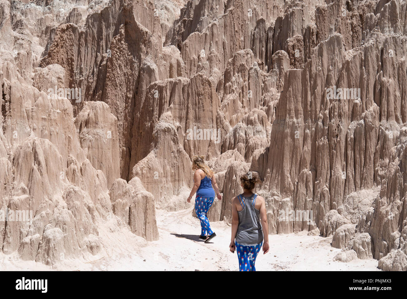 Two female hikers start their hike in Cathedral Gorge State Park. Concept for adventure, female friendship - Stock Image