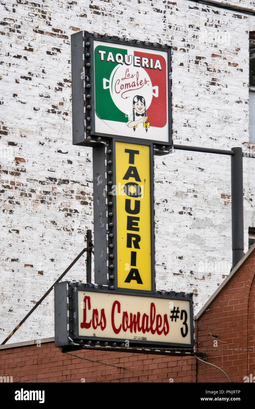 Sign on a Mexican Taqueria, Los Comales, in the Pilsen neighborhood, historic area on the Lower West Side of Chicago, IL. - Stock Image