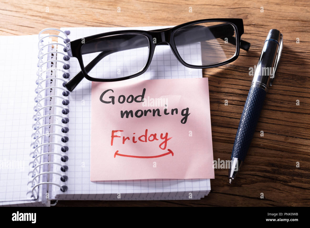 Eye Glasses And Adhesive Note With Good Morning Friday Text On