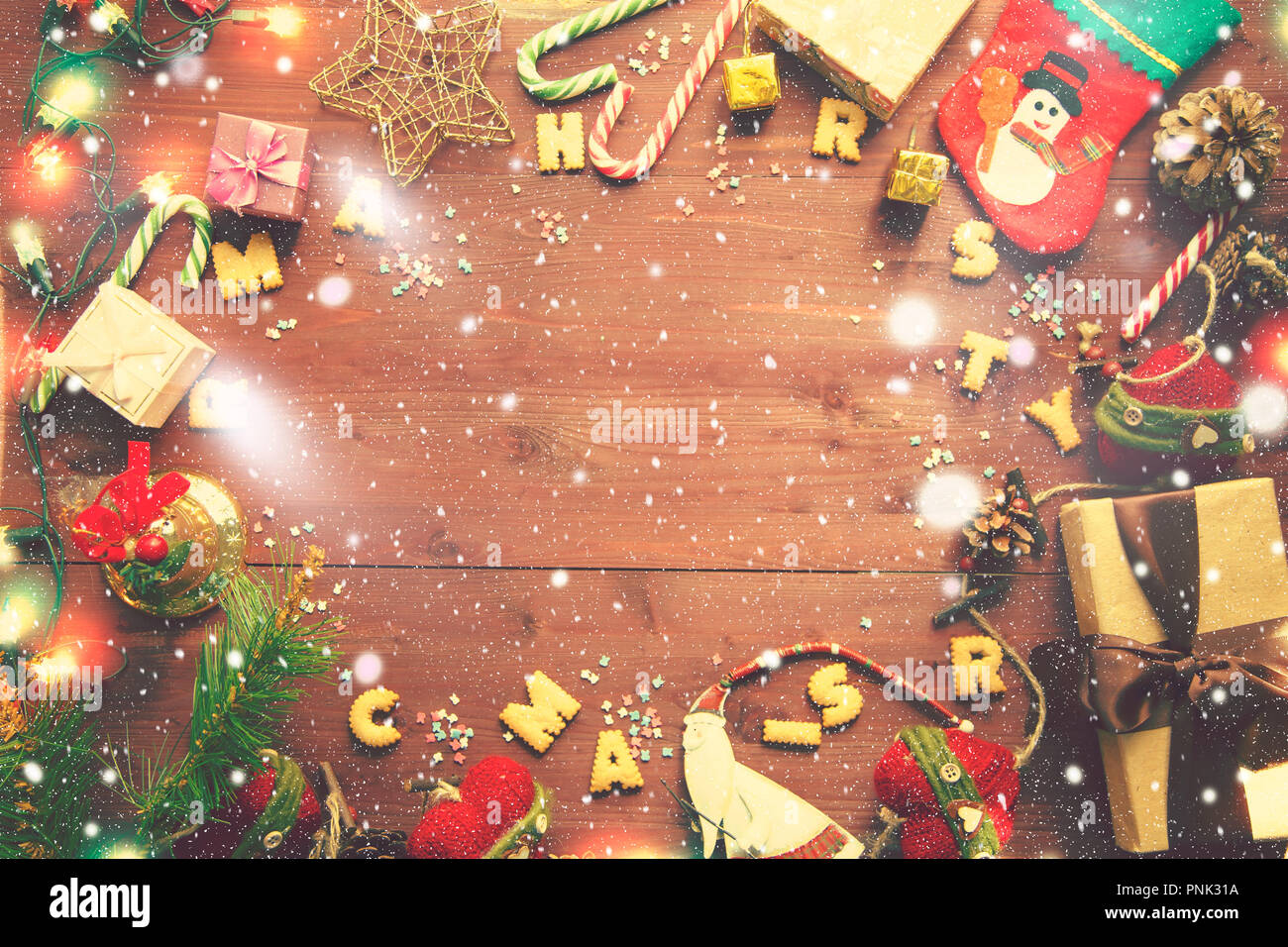 Christmas and New Year's concept. Gifts, flashlights, bell, Christmas tree, snow on a wooden background. Top view Flat lay Copy space - Stock Image