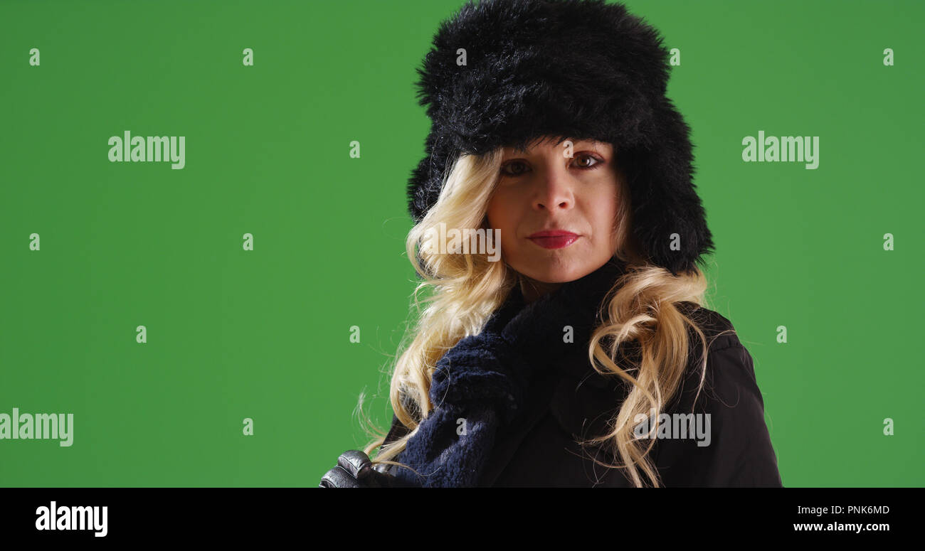 055ac8a2ad1 Elegant Caucasian woman in winter clothes looking at camera on green screen  - Stock Image