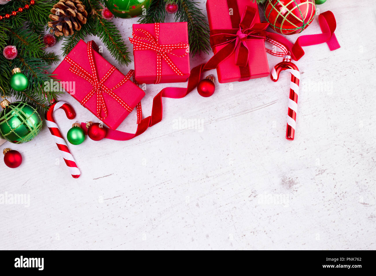 Christmas gift giving flat lay border - christmas presents in red ...