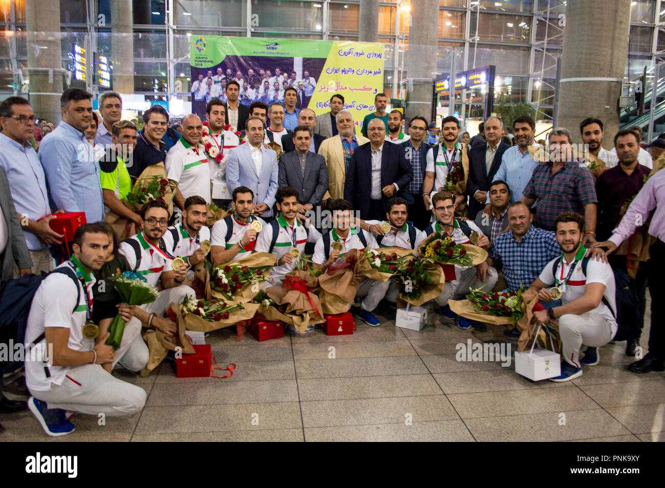 The Iranian water polo team from the 2018 Asian Games posing with their bronze medals - Stock Image