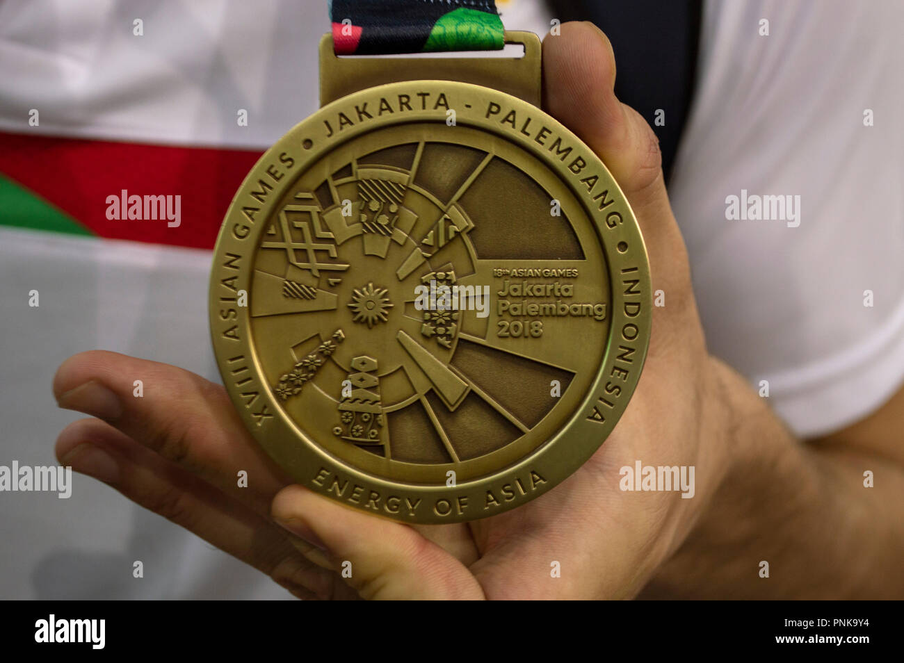 The bronze medal of an Iranian water polo player from the 2018 Asian Games - Stock Image