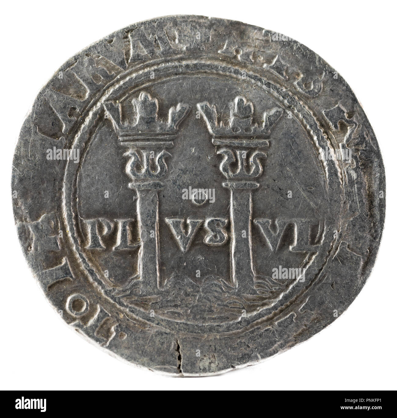 Ancient Spanish silver coin of the Kings Juana and Carlos. Coined in Mexico. Real. Reverse. - Stock Image