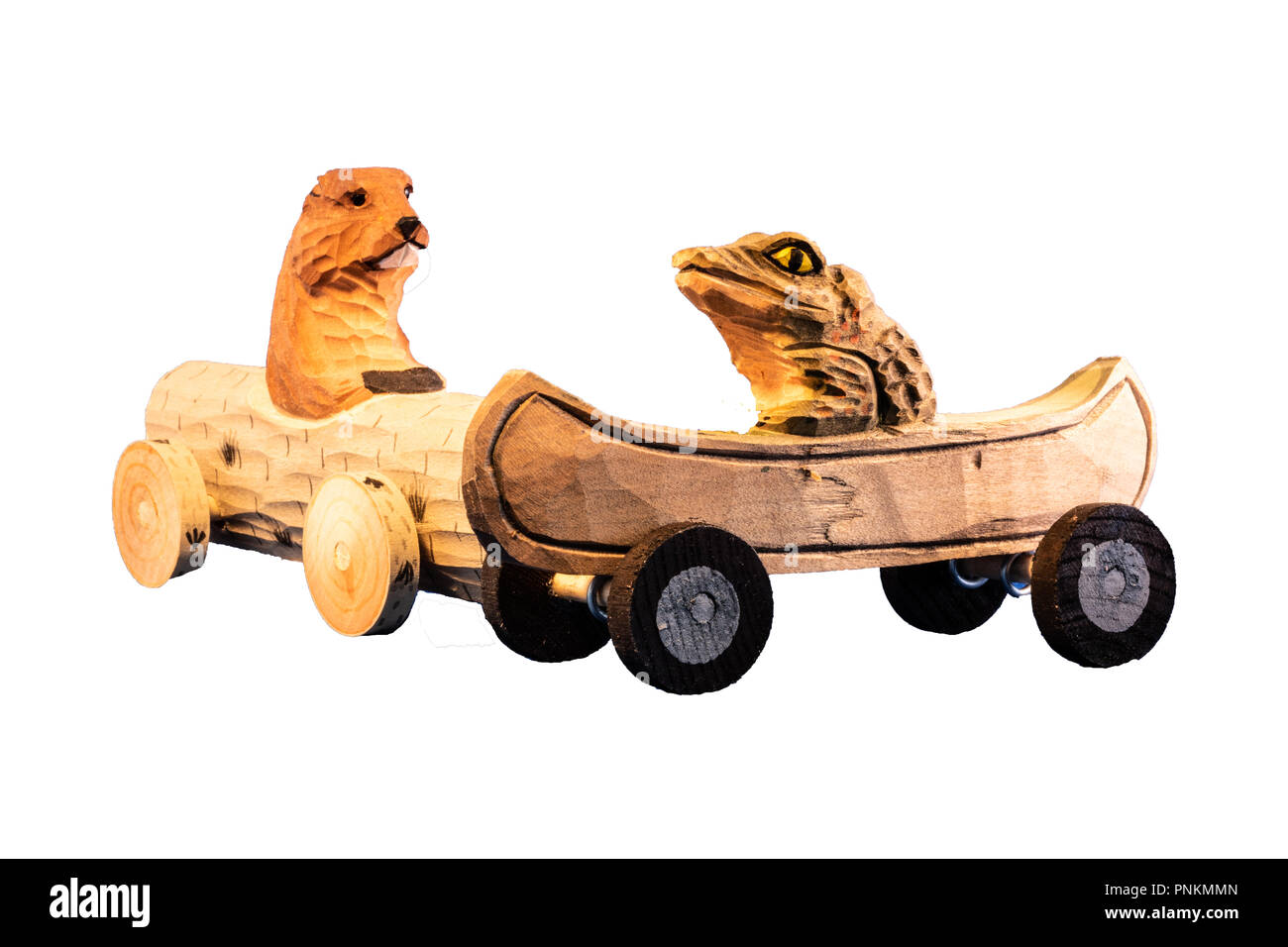 Wooden toy hedgehog and alligator driving small wood sports cars on a collision course, concept for traffic jam, passive aggressive behavior on isolat - Stock Image