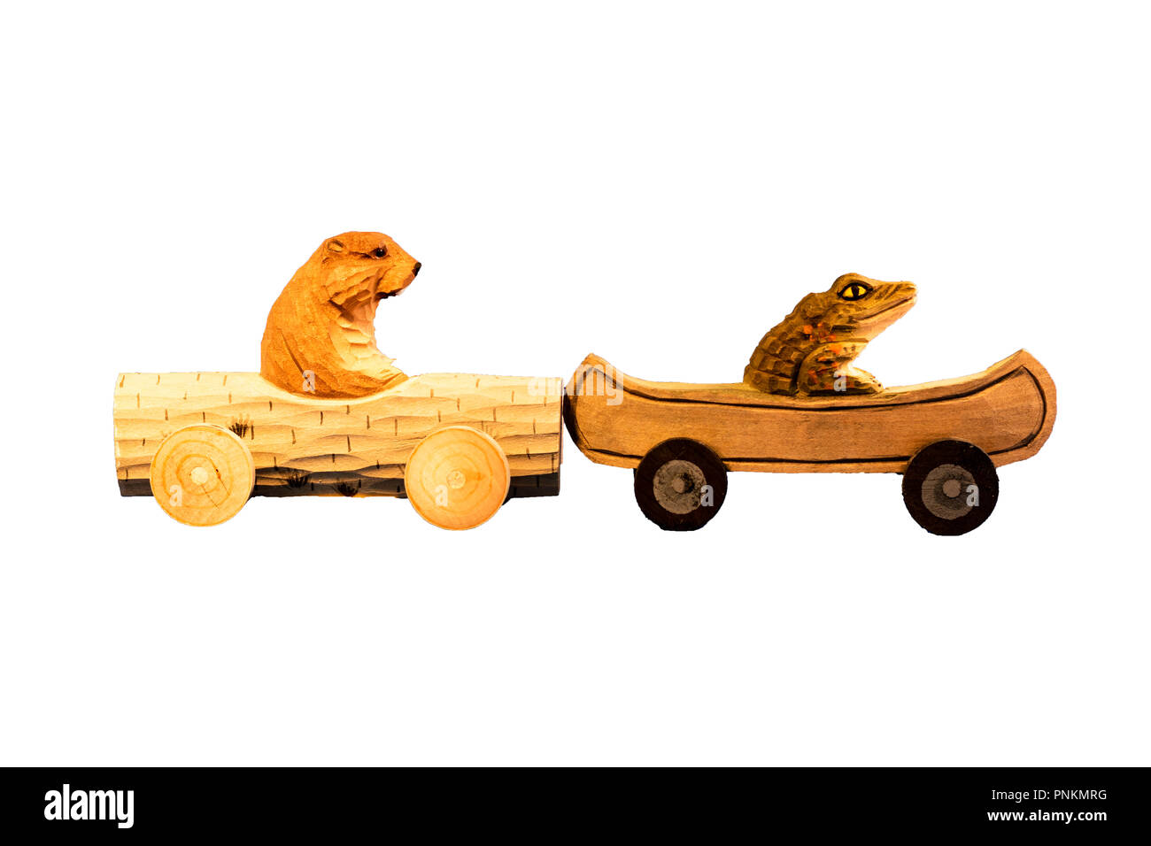 Wooden toy hedgehog and alligator driving small wood sports cars humorous concept for traffic jam, passive aggressive behavior on cut out isolated bac - Stock Image